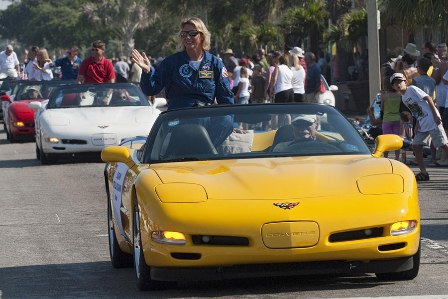 Retired space shuttle astronaut Susan Kilrain waves to spectators from a Chevrolet Corvette during a commemorative parade in Cocoa Beach, Fla.