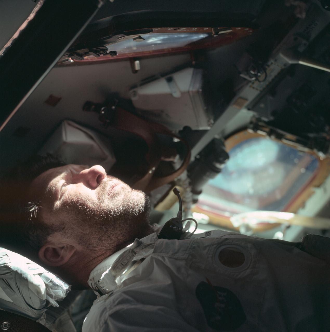 Apollo 7 commander Walter Schirra looks out the rendezvous window on the 9th day of the mission.