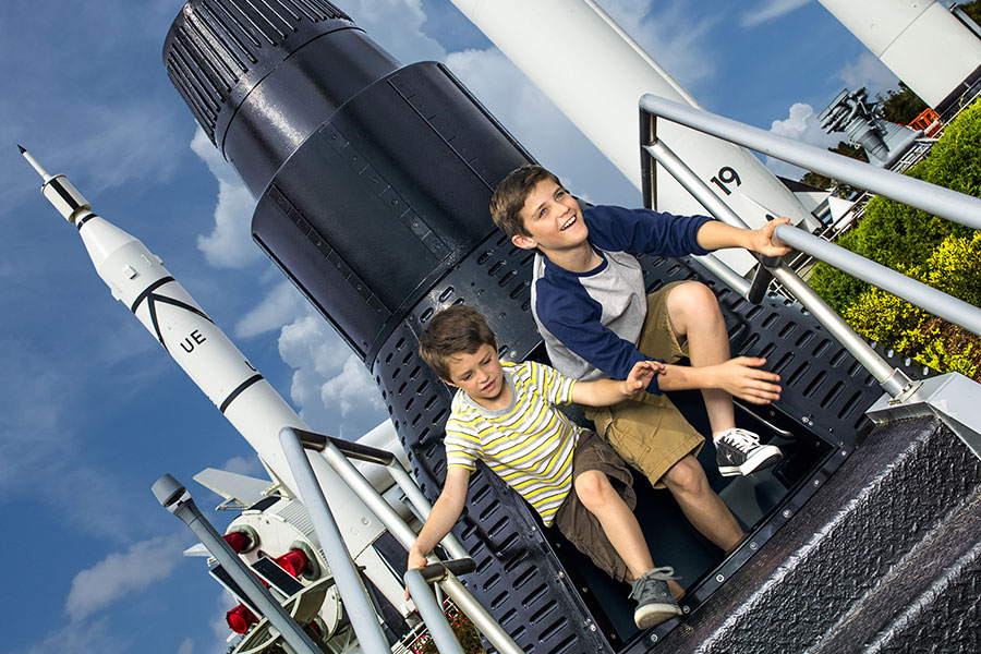 Kids playing in capsule in the Rocket Garden at Kennedy Space Center Visitor Complex.