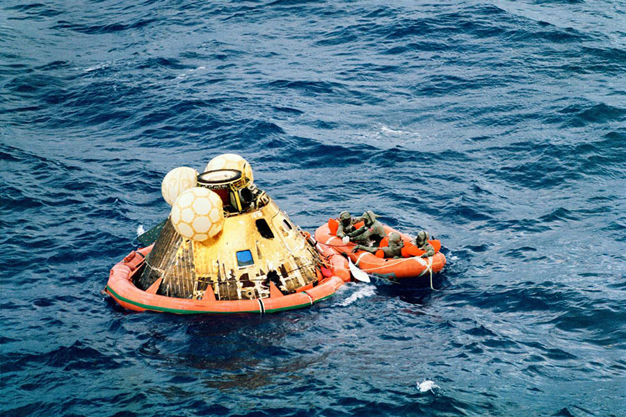 The three Apollo 11 crew men, Neil Armstrong, Buzz Aldrin and Michael Collins, await pickup by a helicopter from the USS Hornet, prime recovery ship for the historic Apollo 11 lunar landing mission. The fourth man in the life raft is a United States Navy underwater demolition team swimmer.