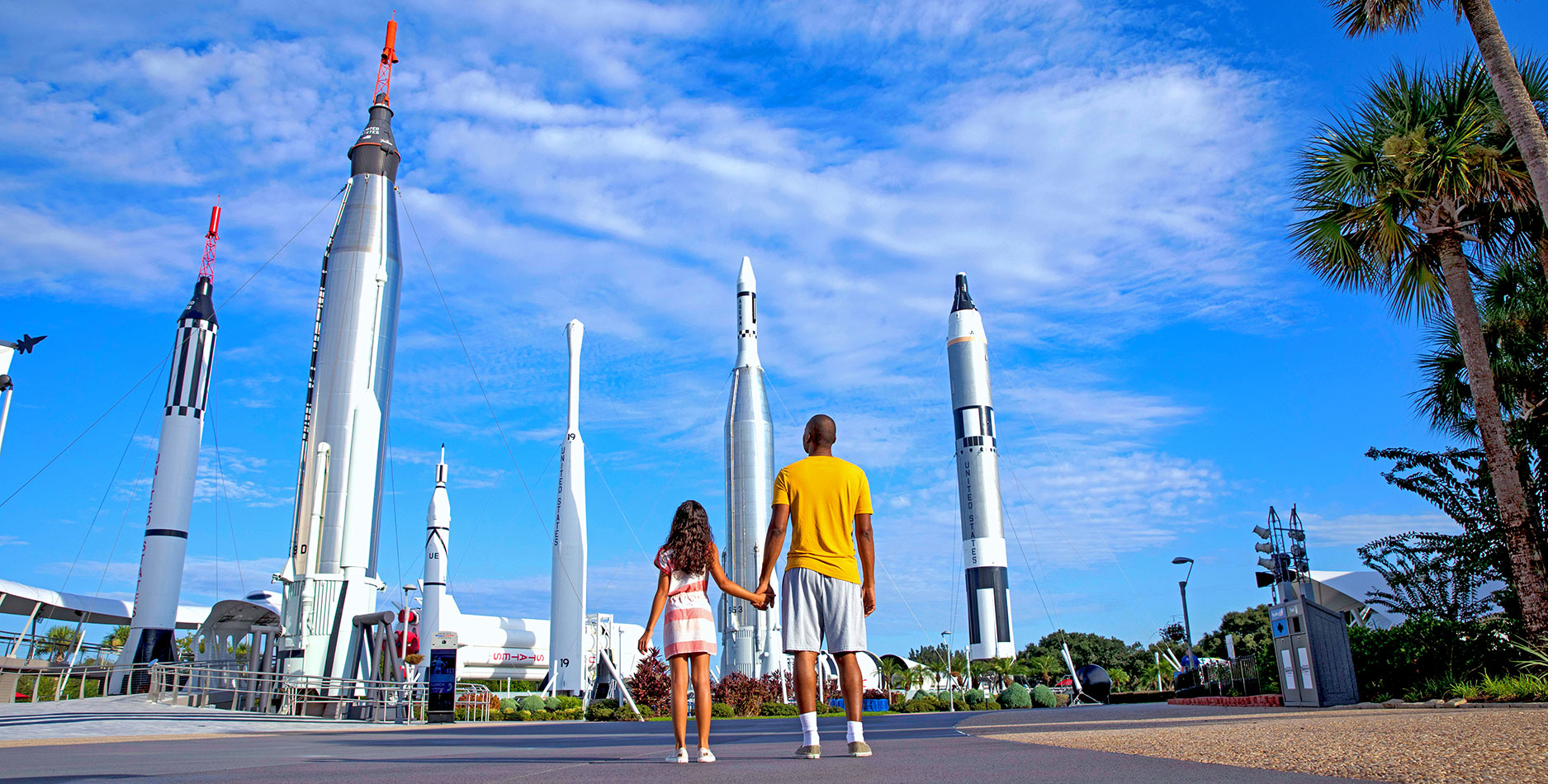Father and daughter look up at the Rocket Garden at the Kennedy Space Center Visitor Complex where Rockets launch and inspiration begins.